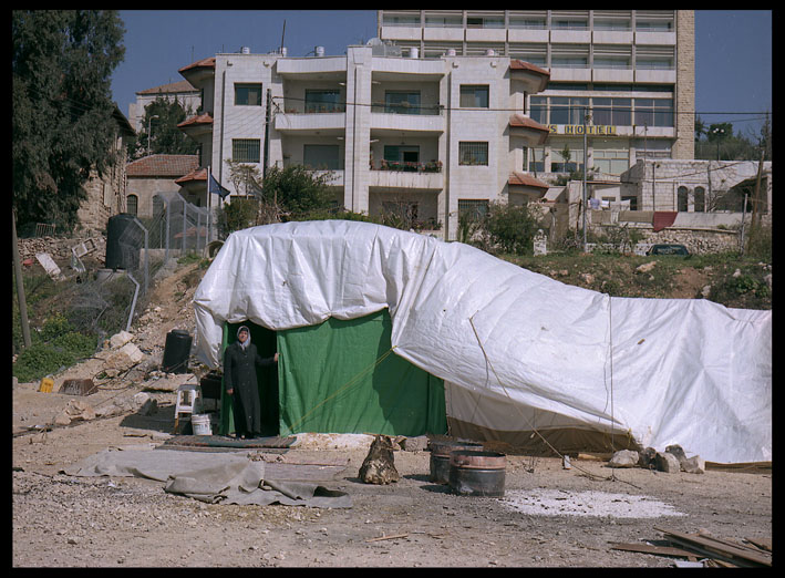Um Kamel in her tent below the home from which she was evicted in East Jerusalem