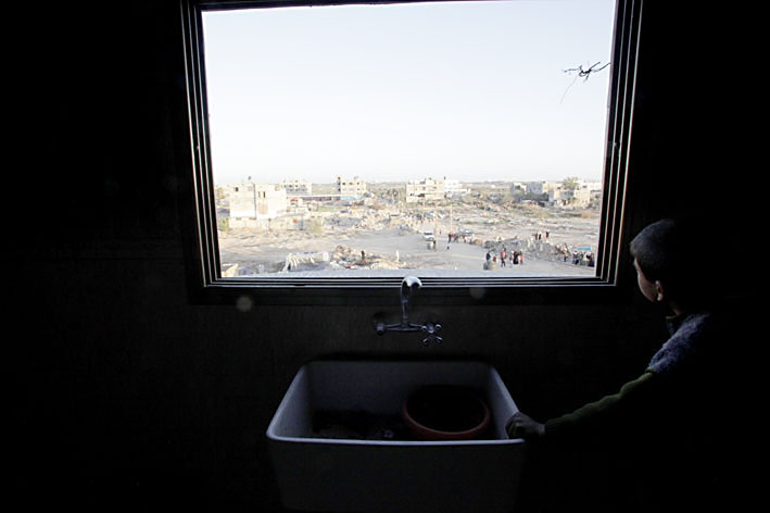 Abdullah a-Samuni at the window he described as being used by IDF snipers