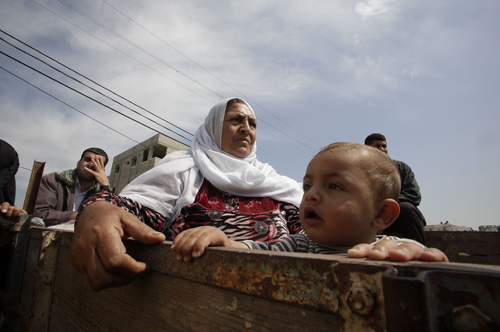 Palestinian woman and grandson waiting for aid