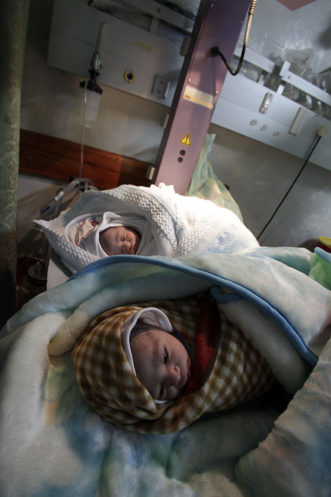 al-Awada Hospital, two new born twins, named by the same names of their grandmother's sons who were killed during the war